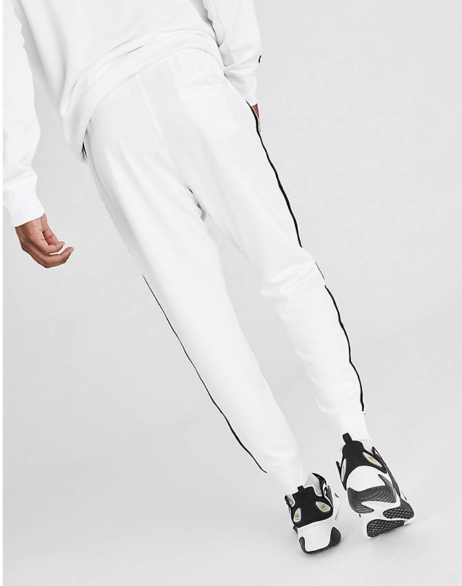 Back Left view of Men's Nike Sportswear Tribute Track Pants in White