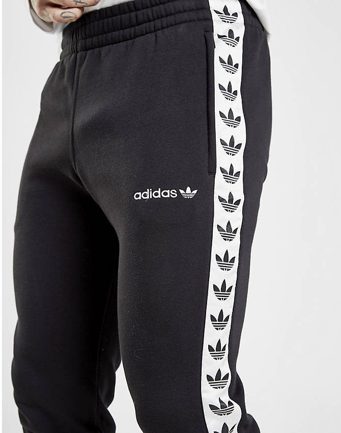 Back Right view of Men's adidas Originals Tape Fleece Track Pants in Black