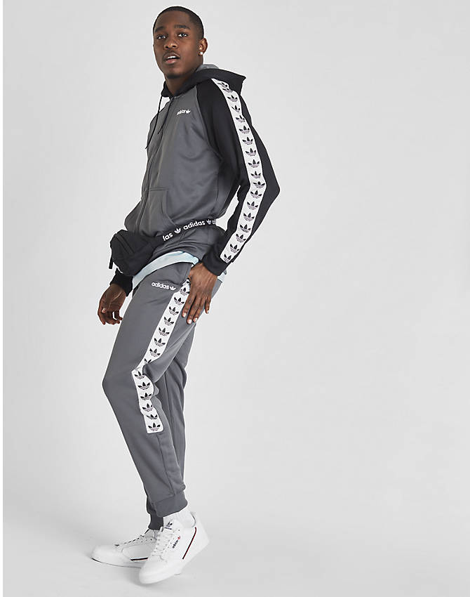 Front view of Men's adidas Originals Tape Poly Track Pants in Grey