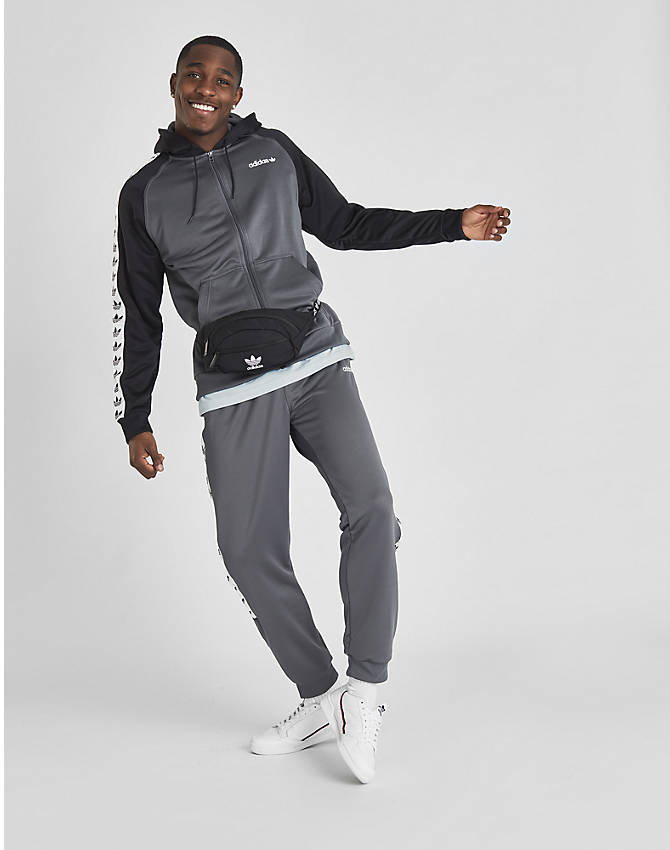 Back Left view of Men's adidas Originals Tape Poly Track Pants in Grey