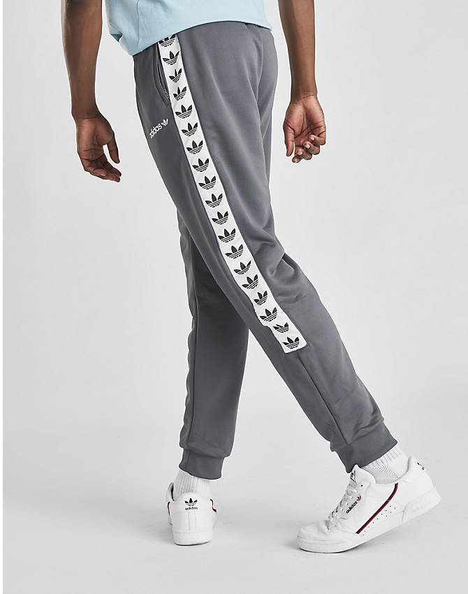 Back Right view of Men's adidas Originals Tape Poly Track Pants in Grey