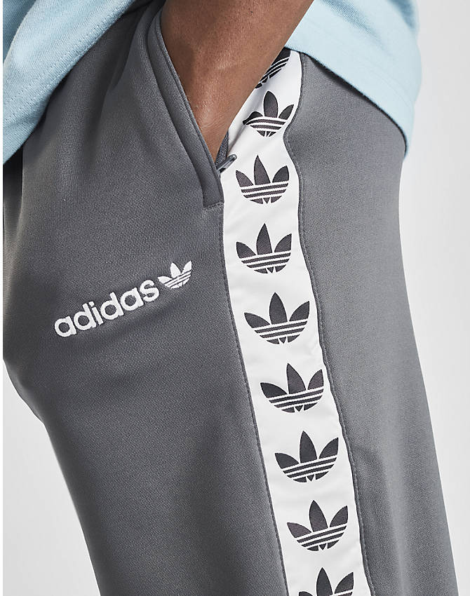 On Model 5 view of Men's adidas Originals Tape Poly Track Pants in Grey