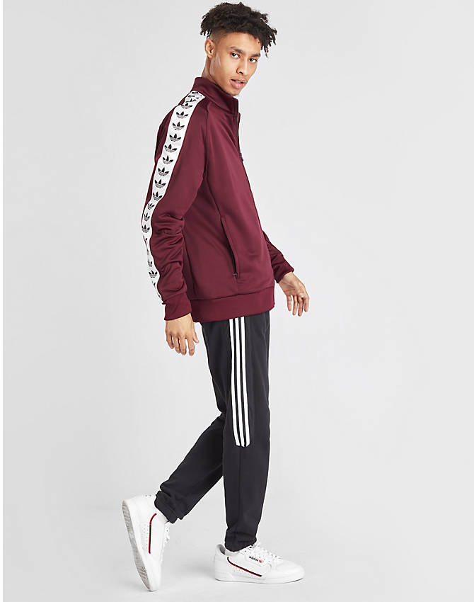 Front Three Quarter view of Men's adidas Originals Taped Firebird Track Jacket in Burgundy