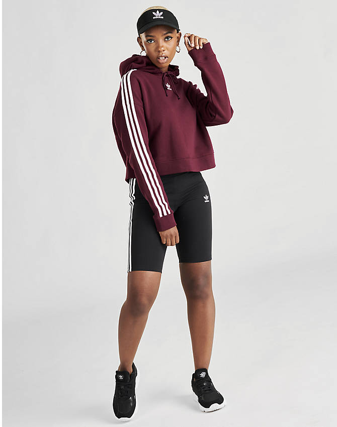 Front Three Quarter view of Women's adidas Originals Taped Hoodie in Dark Burgundy