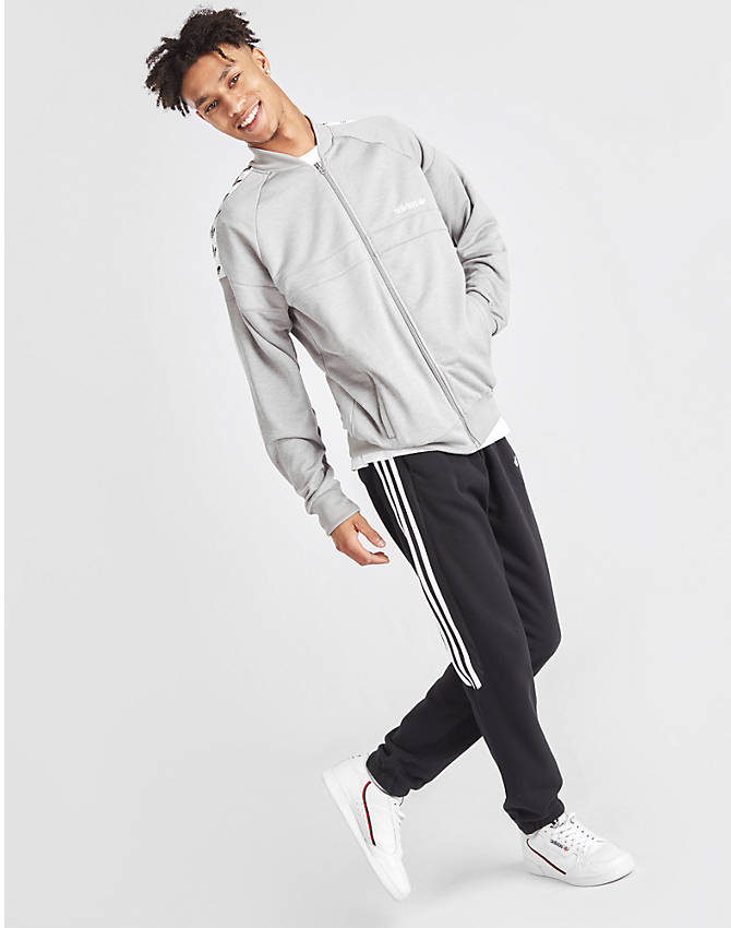 Front Three Quarter view of Men's adidas Originals Itasca Tape Track Jacket in Medium Grey