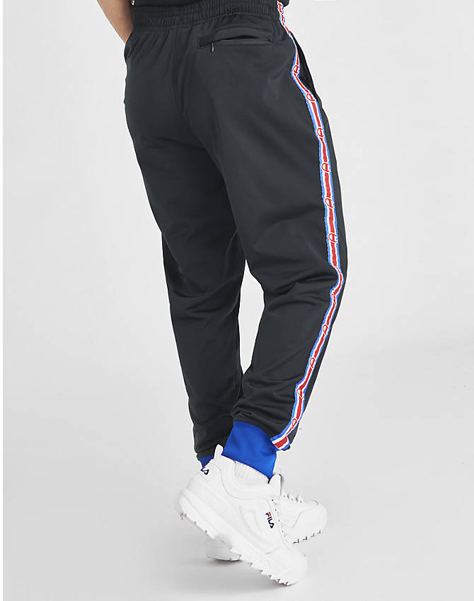 Back Right view of Men's Champion Side Tape Track Jogger Pants in Black/Royal